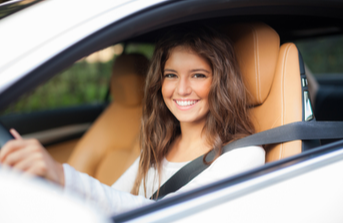 young female driving car
